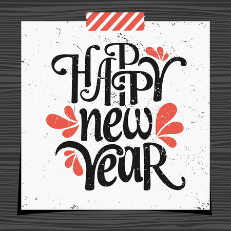 strip design: Happy New Year typographic design greeting card template in black and red on white background. Greeting card for New Year with a strip of washi tape on dark wood background.