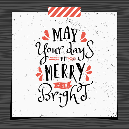 strip design: Christmas typographic design greeting card template. May Your Days be Merry and Bright message in black and red on white background. Greeting card for Christmas with a strip of washi tape on dark wood background.
