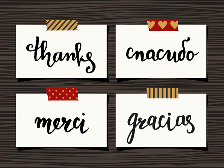 to thank: A set of four Thank You notes on wood background. Hand lettered Thank you in different languages - Spasibo(Russian), Merci(French), Gracias(Spanish).