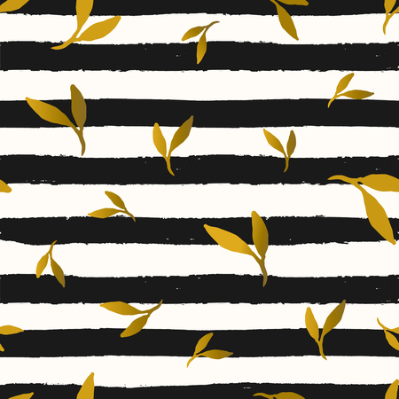 Seamless repeat pattern with gold foil leaves on black and white stripes background. Tiling festive background, greeting card or wrapping paper.