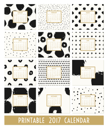 month: Twelve month 2017 calendar template. Hand drawn round brush strokes and doodles in black, gold and cream.