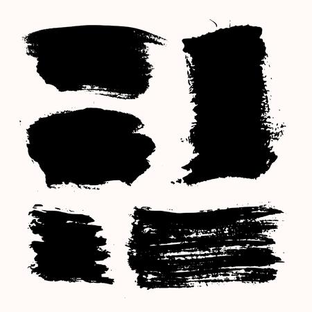 Un conjunto de pinceladas de tinta negro, aislado sobre fondo blanco. Dibujado a mano elementos de diseño gráfico con espacio de copia. Foto de archivo - 75748636