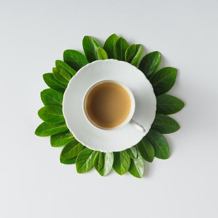 spring leaf: Creative flat lay morning coffee in flower shape.