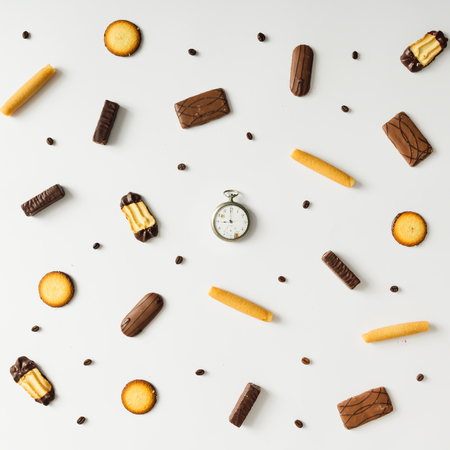 tea and biscuits: Bright sweet snack pattern with vintage pocket watch. Time concept.