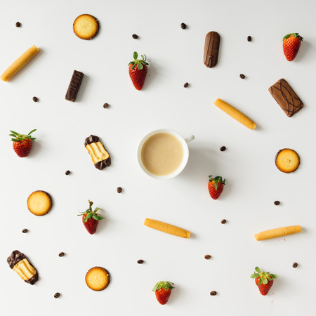 chocolate biscuit: Colourful bright pattern made of natural things with coffee cup.