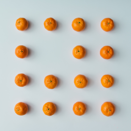 minimal: Creative pattern made of tangerines with copy space on bright background. Flat lay minimal concept. Stock Photo