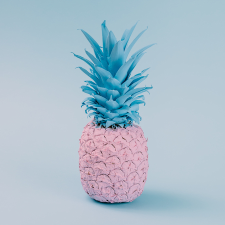 Pink pineapple on blue pastel background. Minimal style. Food concept. Stock fotó