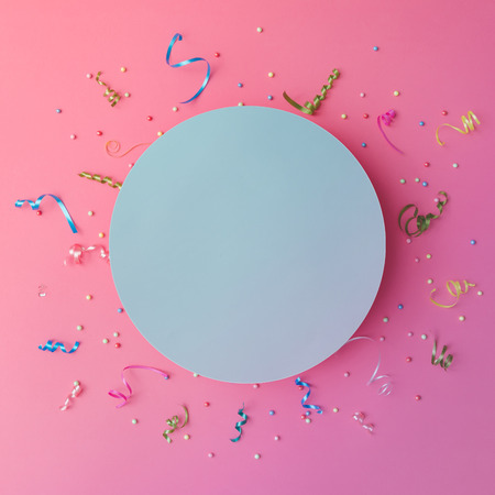 exploding: Colorul party streamers on pink background. Celebration concept. Flat lay. Stock Photo