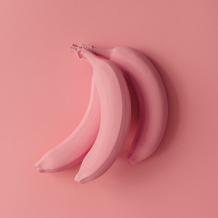 Pink bananas on pink background. Minimal style. Flat lay.