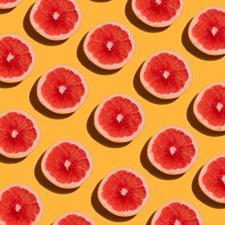 Grapefruit pattern on yellow background. Minimal flat lay concept. Imagens - 68074839