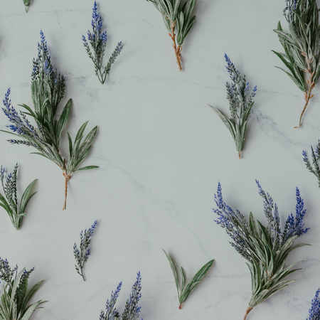 Creative mock up layout made of lavender branches with copy space on table. Homemade flat lay concept.
