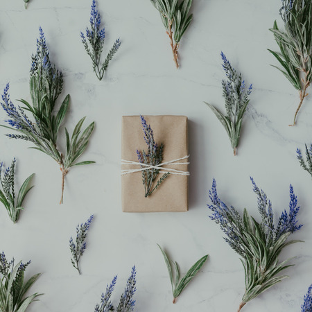 Creative mock up layout made of lavender branches with wrapped soap on table. Homemade flat lay concept. Stock Photo
