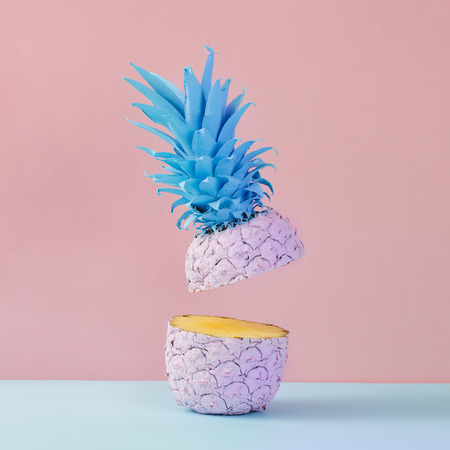 Pink pineapple on yellow background. Minimal style. Food concept. Foto de archivo