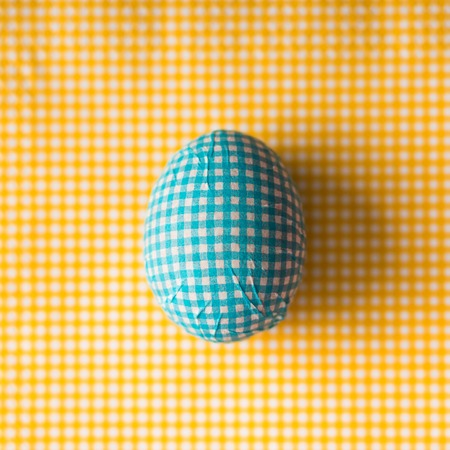 Top view of Easter egg decorated with paper napkin