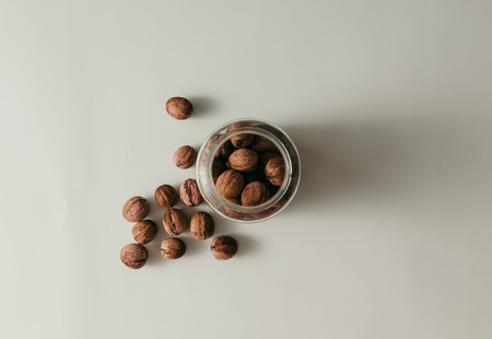 Top view of old glass jar with walnuts