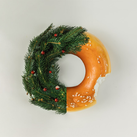 Christmas wreath made of pine branches and bagel. Flat lay. Holiday concept.