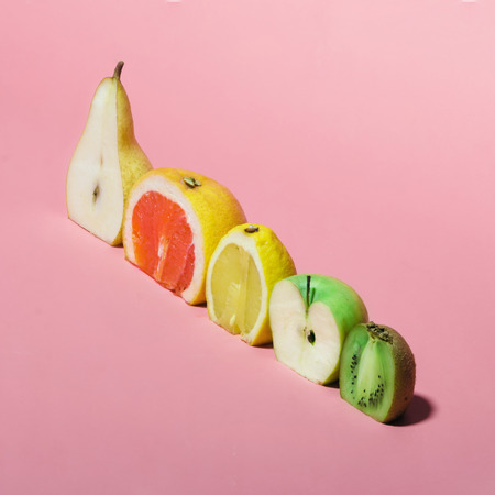 Various fruits sliced in half. Minimal concpet.