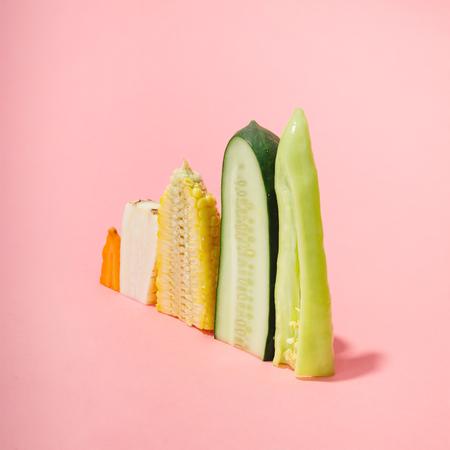 Various vegetables sliced in half. Minimal concept.