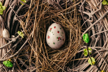 Decorated Easter egg in bird nest Stock Photo