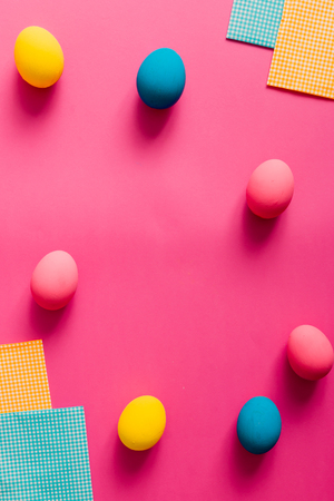 Colorful Easter eggs on pink paper Stock Photo