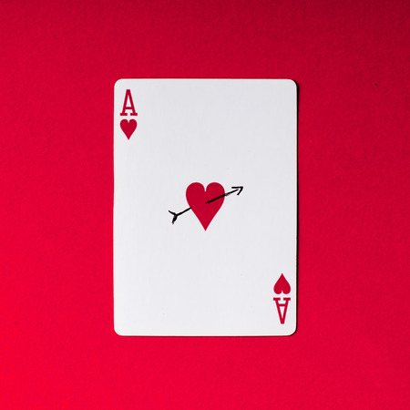 Ace of hearts on red background. Love concept.