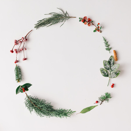 Christmas round frame made of natural winter things. Flat lay. Stock Photo