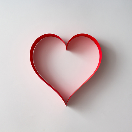 Paper heart shape decoration on white background. Love cocnept. Flat lay.