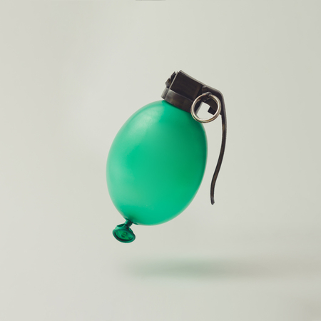 Balloon hand grenade bomb on white background. Minimal party concept. Stock Photo