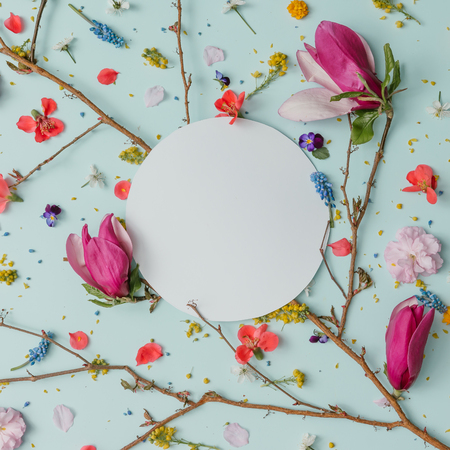 Creative pattern made of colorful spring flowers with copy space. Minimal style. Flat lay.