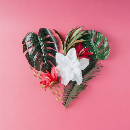 Tropical leaves and flowers in shape of a heart. Mothers day love concept. Flat lay. Stock Photo - 76156388