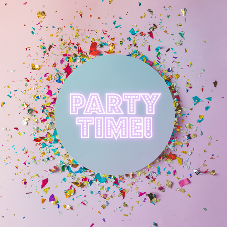 Colorful celebration background with party confetti on pink background. Flat lay.