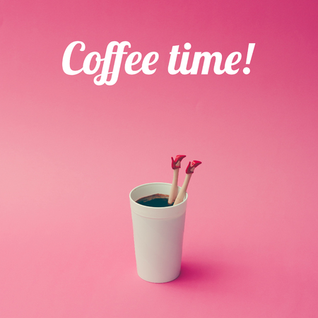 Coffee cup with female doll legs on pink background. Coffee concept. Stock Photo