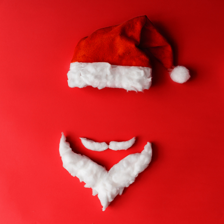 Santa Claus minimal concept. Christmas New Year flat lay. Фото со стока