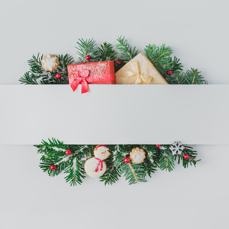 Creative layout made of Christmas tree branches with decoration and snow. Flat lay. Nature New Year concept.