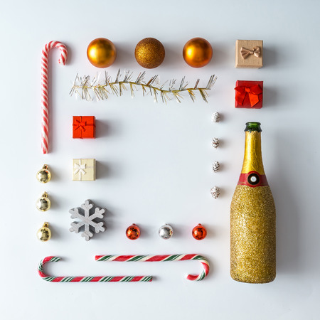 Creative Christmas layout made of christmas winter decoration and champagne. Flat lay. Nature New Year concept.