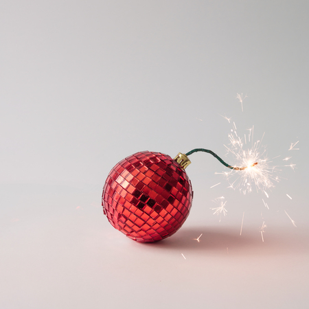 Christmas tree decoration fuse bomb. Time for celebration. New Year concept. Фото со стока