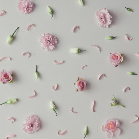 Creative pattern made of violet and pink flowers. Flat lay. Minimal season background.