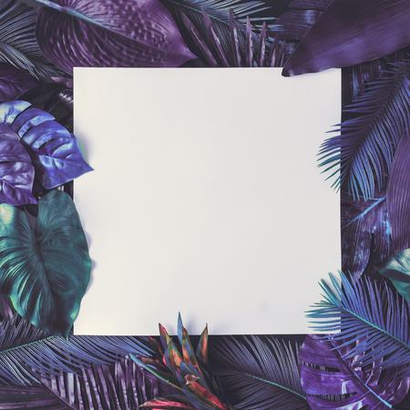 Creative tropic purple leaves layout. Supernatural concept. Flat lay. Ultra violet colors. Reklamní fotografie