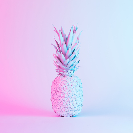 Pineapple in vibrant bold gradient holographic neon  colors. Concept art. Minimal surrealism background. Zdjęcie Seryjne