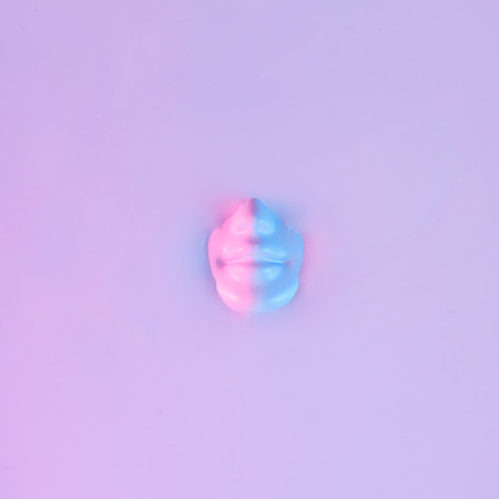 Human head submerged in water. Neon pink and purple colors. Ultra violet concept.