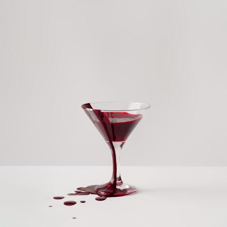 Martini glass full of blood. Minimal horror concept.