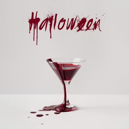 Martini glass full of blood. Minimal Halloween concept.