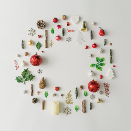 Christmas decoration wreath made of various winter and holiday objects. Minimal New Year flat lay background.
