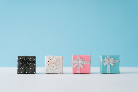 Colorful gift boxes on pastel blue background. Minimal Christmas or New Year concept.