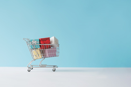Shopping cart full with gift boxes. Minimal concept.