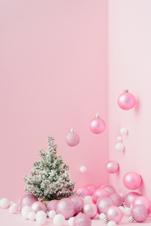 Creative Christmas design pink pastel color background with Christmas tree. New Year concept.