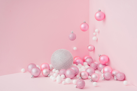 Creative Christmas design pink pastel color background. New Year party concept.