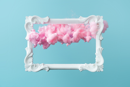 White vintage frame on pastel blue background with abstract pink cloud shapes. Minimal border composition. Imagens