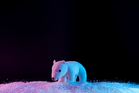 Polar bear on snow in vibrant bold gradient holographic colors. Christmas concept art. Minimal New Year surrealism.