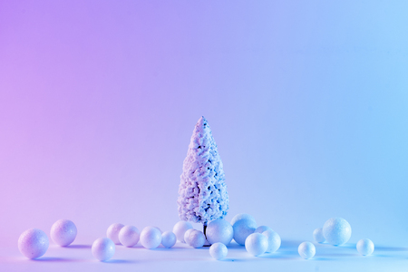 Snowy Christmas tree in vibrant bold gradient holographic colors. Concept art. Minimal New Year surrealism.